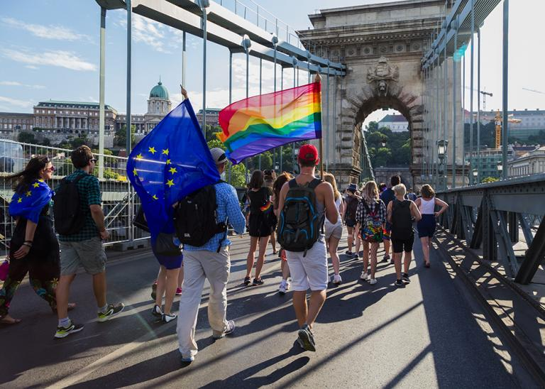 Citizens march through Budapest during a Gay Pride event to support LGBTQ rights.